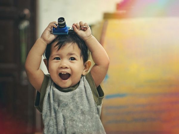 Camera Childhood Child Offspring Portrait One Person Baby Young Looking At Camera Indoors  Real People Emotion Fun Men Casual Clothing Holding Innocence Mouth Mouth Open