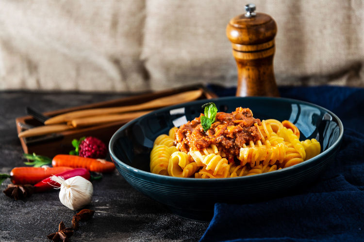 Pasta in bowl on table