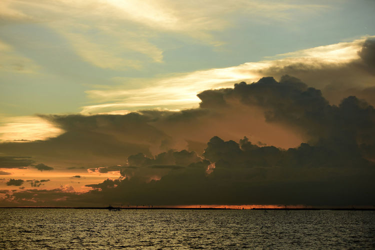 Sky Cloud - Sky Sunset Water Beauty In Nature Scenics - Nature Tranquility Tranquil Scene Sea Waterfront Nature No People Idyllic Orange Color Non-urban Scene Dramatic Sky Horizon Over Water Outdoors Horizon