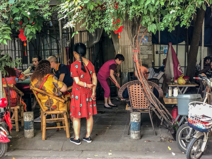 Street scene in a residential area in Kunming, China Building Exterior City Group Of People Leisure Activity Lifestyles Market Outdoors Real People