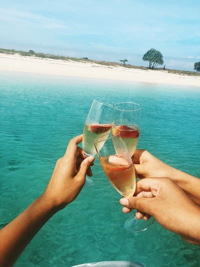 Bubbles on the beach Water Sea Hand Human Hand Food And Drink Refreshment Lifestyles