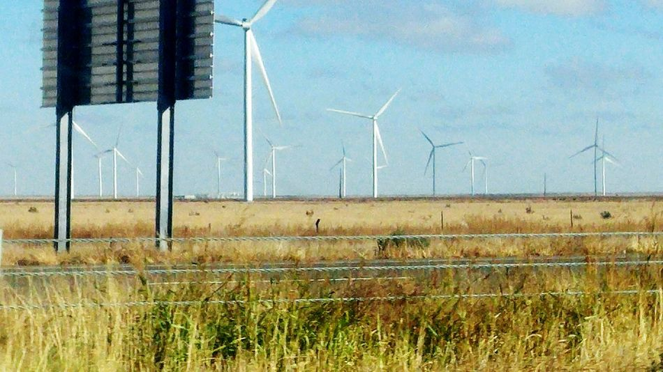 Enjoy The New Normal Alternative Energy Wind Power Wind Turbine Renewable Energy Environmental Conservation Fuel And Power Generation Electricity  Windmill Rural Scene Nature Field No People Day Sky Landscape Grass Agriculture Electricity Pylon Outdoors