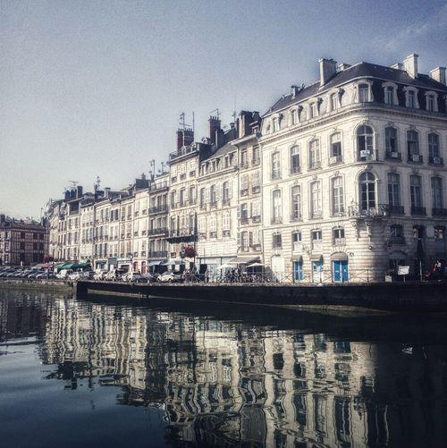 Architecture Building Exterior Built Structure Reflection Waterfront Water Sky Outdoors Day City Travel Destinations No People Clear Sky Nautical Vessel