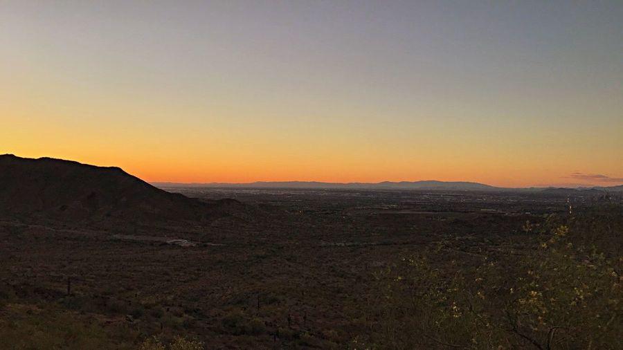 Beautiful sunset from South Mountain tTranquil ScenelLandscapesScenicstTranquilitynNaturebBeauty In NaturenNo PeopleoOutdoorssSkymMountainaArid ClimatedDesertmMountain RangecClear SkydDay