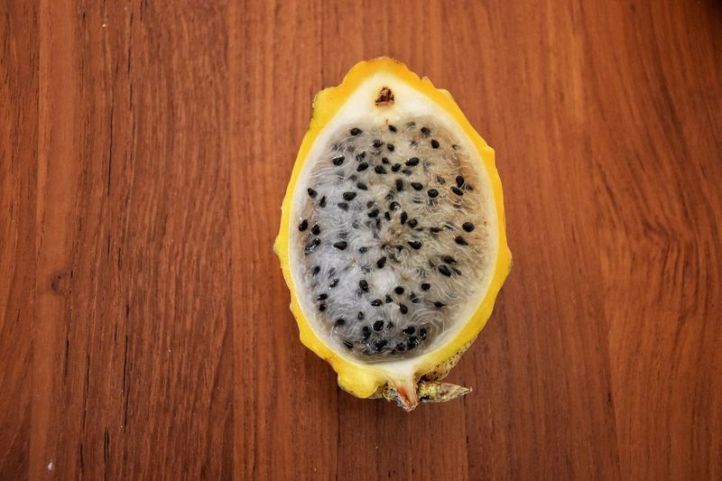 Pitahaya Fruit Pitahaya Pitaya EyeEm Selects Food And Drink Food Wood - Material Fruit Directly Above Table Healthy Eating Freshness Seed No People High Angle View SLICE
