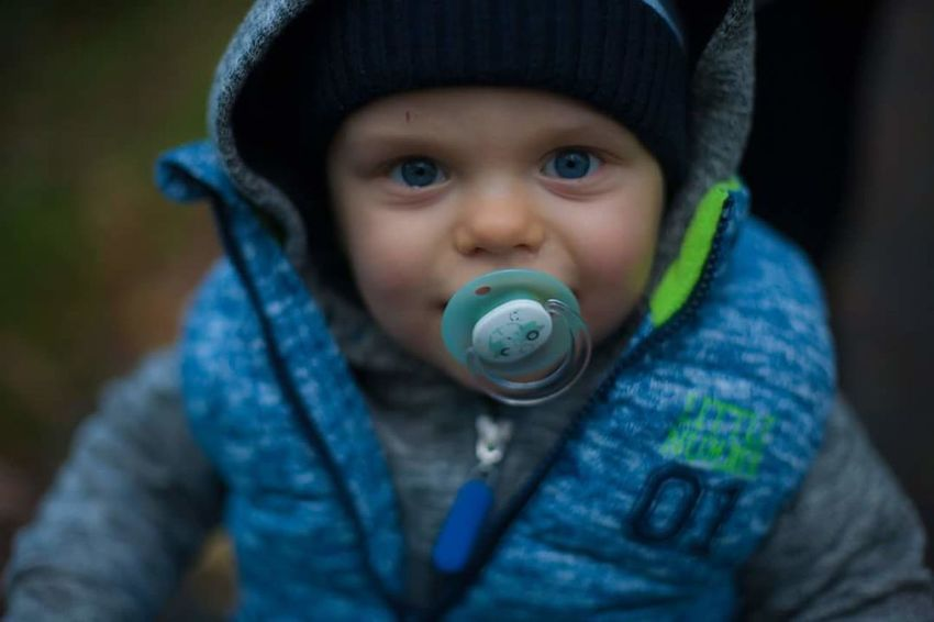 Childhood Children Only Child One Person Front View People Casual Clothing One Boy Only Headshot Playing Looking At Camera Portrait Close-up Males  Day Pacifier Outdoors Warm Clothing Bubble Wand