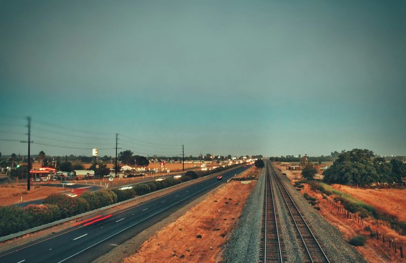 High angle view of road by railroad tracks