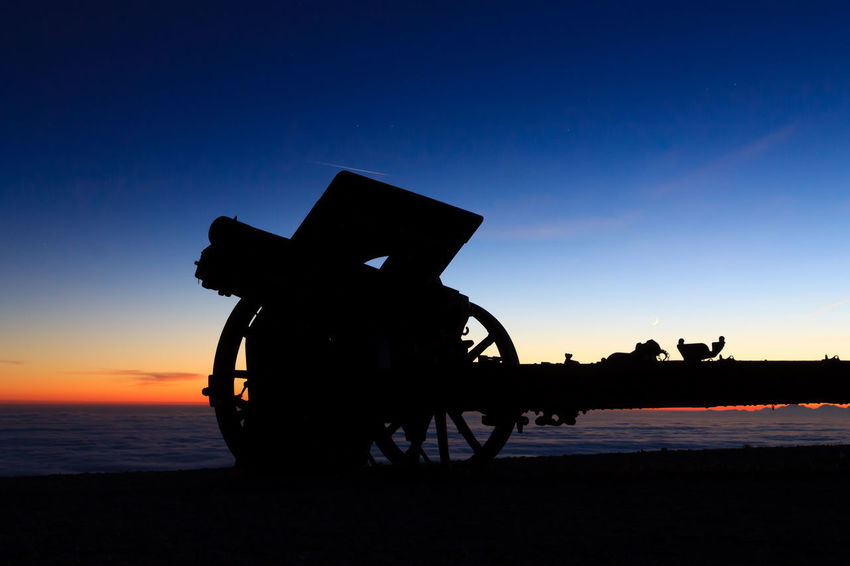 Cannon silhouette at dawn. Monte grappa first world War memorial monument, Italy Landscape Italy Italian Landmark Cannon Silhouette Dawn Sunset Sunset_collection Monte Grappa Bassano Del Grappa Monument War Memorial Cannonphotography Background Backlight Astronomy Sunset Silhouette Sea Sky Calm Memorial National Monument