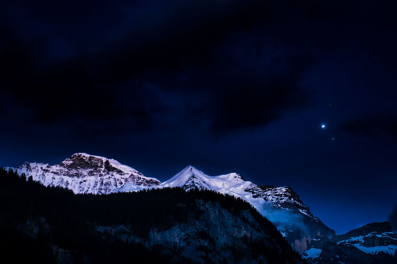 Beauty In Nature Cloud - Sky Cold Temperature Dark Environment Landscape Moonlight Mountain Mountain Peak Mountain Range Nature Night No People Scenics - Nature Sky Snow Snowcapped Mountain Star - Space Tranquil Scene Tranquility Winter