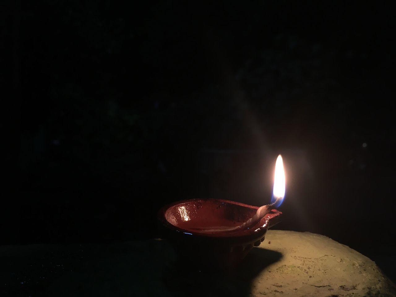 burning, flame, heat - temperature, candle, diya - oil lamp, close-up, no people, oil lamp, illuminated, night, diwali, indoors, black background