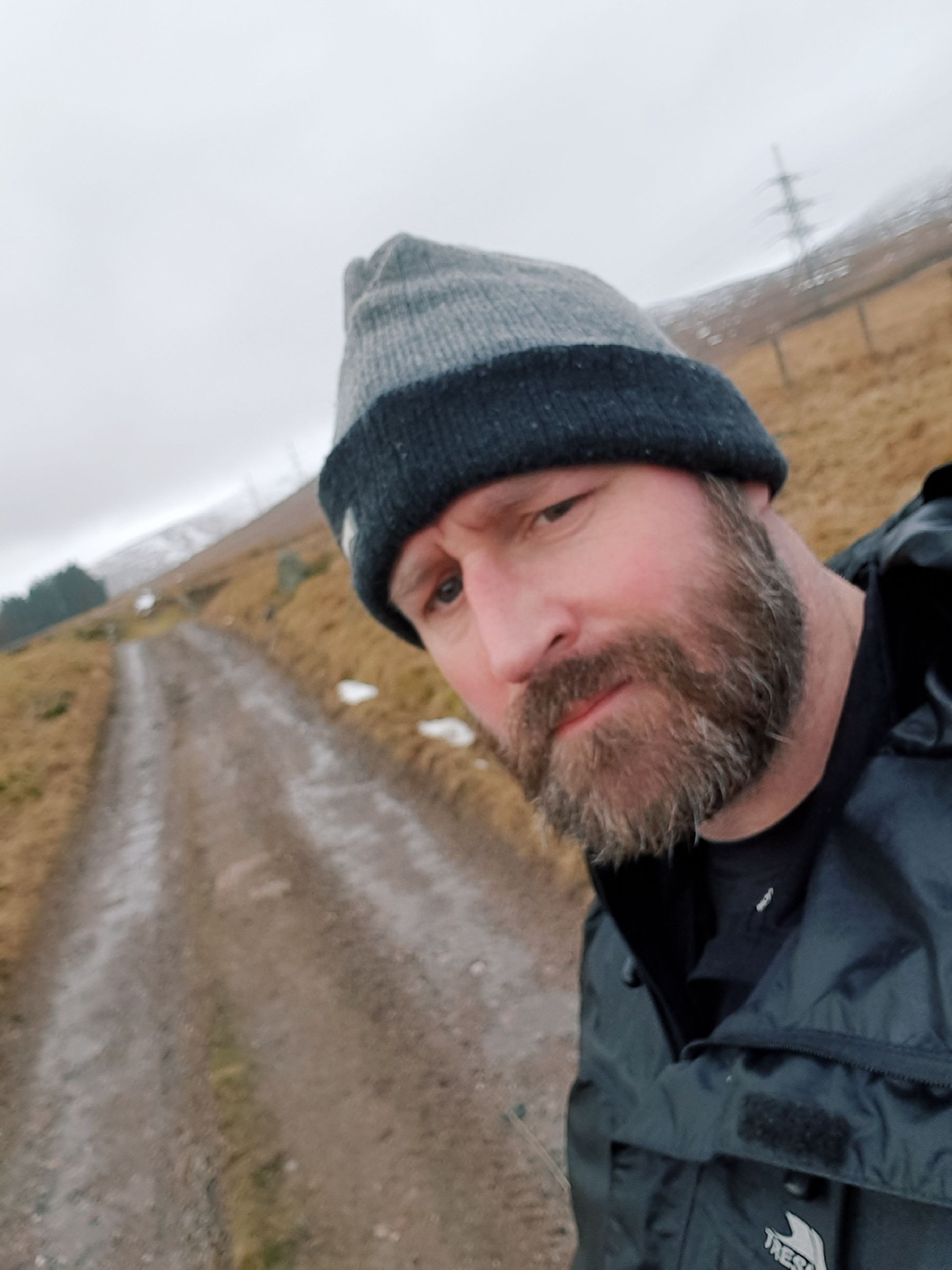 beard, facial hair, portrait, one person, clothing, men, lifestyles, knit hat, winter, headshot, cold temperature, looking at camera, road, real people, hat, males, standing, warm clothing, outdoors, mature men