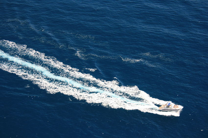 Luxury speed boat leaving white track on blue sea water. Beauty In Nature Blue Sea And Clear Water Enjoying Life High Angle View Lifestyles Mode Of Transportation Motion Nature Nautical Vessel Sea Speed Summer Activities Summer Adventures Transportation Travel Wake - Water Water Wave Wave Pattern Weekend Activities Weekend Getaway