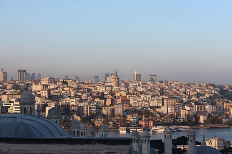 Aerial view of buildings in city against clear sky in istanbul and galata