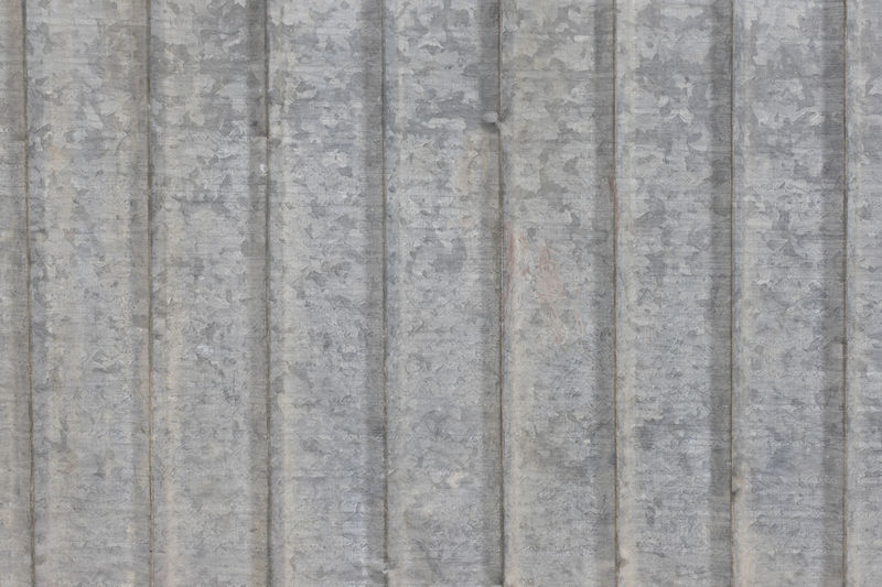 detail of gray metal ribbed texture Metal Ribbed Texture Gray Background Pattern Surface Closeup Detail Panel Wall Industrial Material Stainless Grey Textured  Worn Industry Corrugated Exterior Metallic Parallel Steel Seamless Structure Architecture Aluminum Painted Grunge Iron Ridged Grooved Tiling Hangar Silver  Backdrop Object CAST Rough Lines Wavy Sheet Smooth Seamlessly Full Frame Old Silver Colored