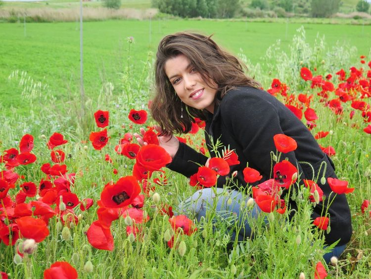 Red Flower Beauty Long Hair Portrait Rural Scene Beautiful Woman Only Women Adult Field One Person Growth Poppy Beautiful People One Woman Only Agriculture Serene People Adults Only Nature Outdoors Popies Smile Smiling Enjoying Nature Happy Women Around The World