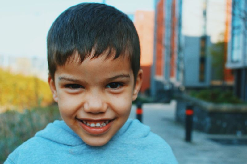 The Portraitist - 2017 EyeEm Awards Vscocam Childhood Portrait Smiling Focus On Foreground Close-up Outdoors Cheerful