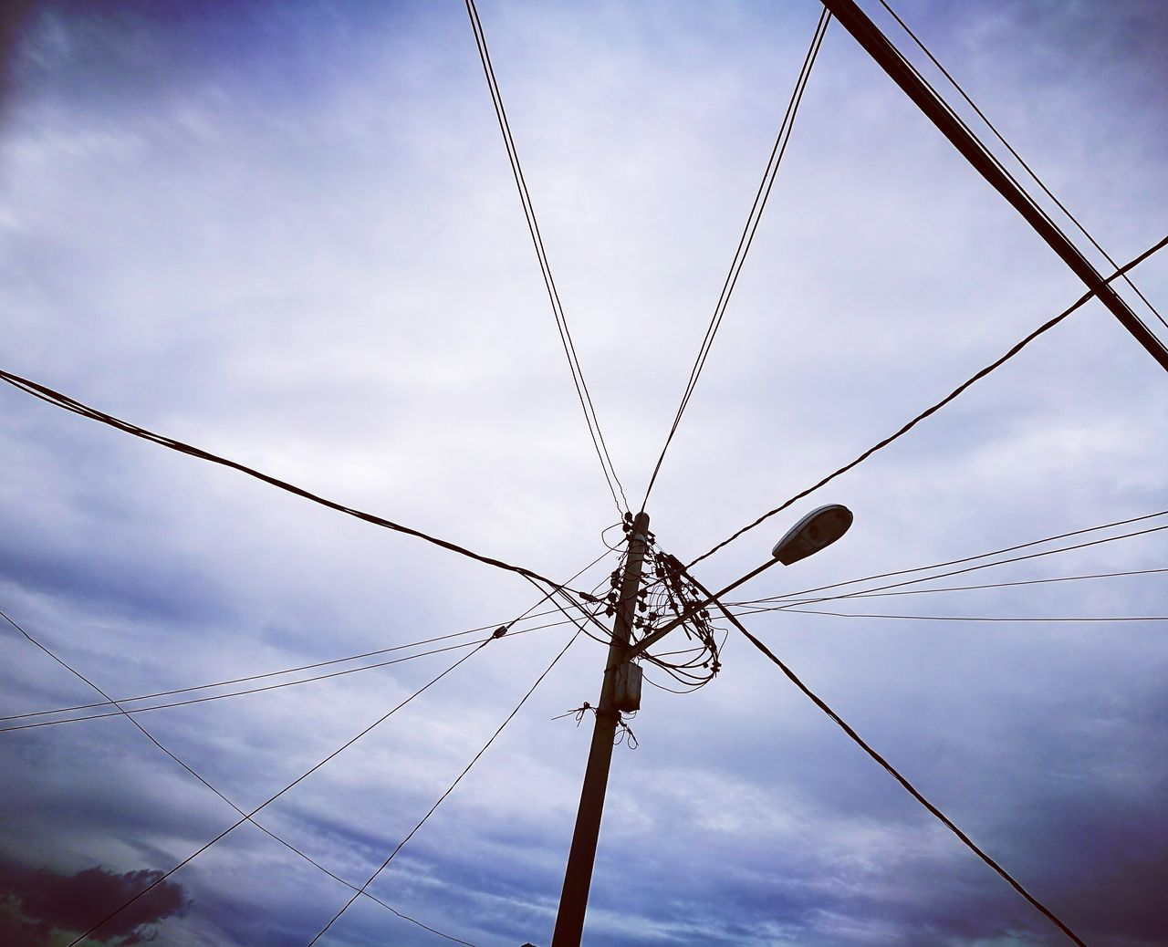 cable, connection, sky, power line, cloud - sky, low angle view, power supply, electricity, day, outdoors, fuel and power generation, technology, no people, complexity, telephone line, animal themes