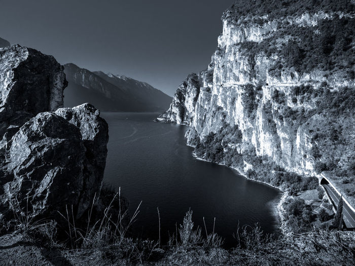 Schroffe Felsküste am Gardasee Beauty In Nature Clear Sky Day Mountain Nature No People Outdoors Rock - Object Rock Formation Scenics Sea Sky Tranquil Scene Tranquility Water