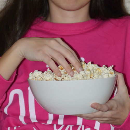 Bowl Eating Food Food And Drink Girls Hand Human Body Part One Person Popcorn Snack Food Stories