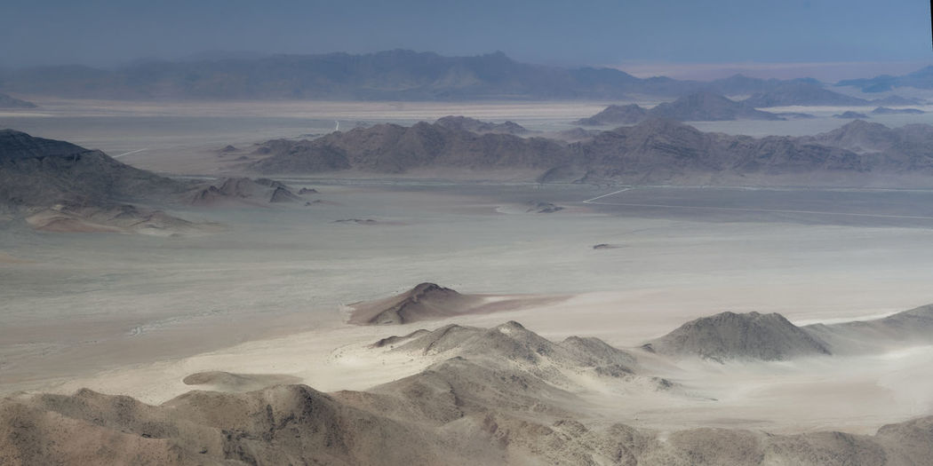 Approaching my photoshooting location from the air Arid Climate Beauty In Nature Day Fog Geology Landscape Mountain Mountain Range Nature No People Outdoors Physical Geography Scenics Sky Tranquil Scene Tranquility Travel Destinations Volcanic Landscape