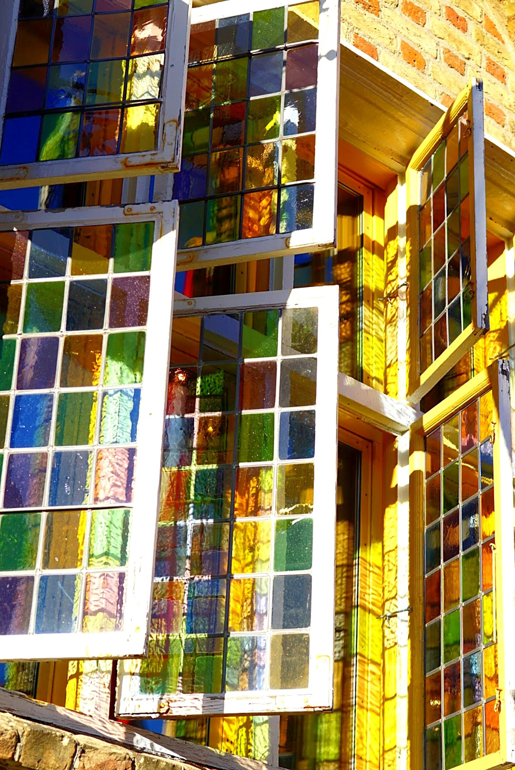 window, building exterior, architecture, built structure, no people, low angle view, outdoors, day, multi colored, close-up