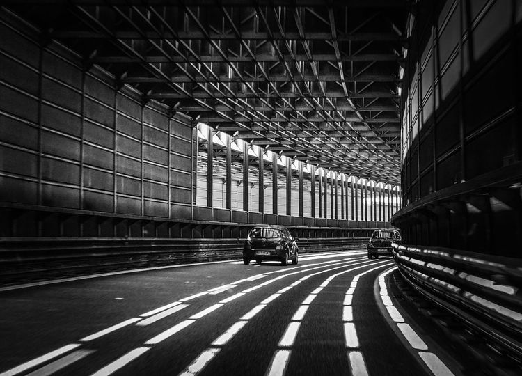 Transportation Built Structure Architecture Real People Indoors  Road Two People Day Men Illuminated City People Italy❤️ Black And White Black And White Photography The Week Of Eyeem The Week On Eyem The Week on EyeEm Editors Picks Welcome To Black Welcome To Black And White Your Ticket To Europe HUAWEI Photo Award: After Dark