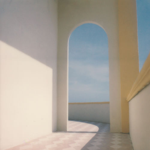 Analogue Photography Arcade Arch Architectural Column Architecture Building Built Structure Corridor Day Door Film Photography Indoors  Nature No People Polaroid Sea Shadow Sky Sunlight Wall Wall - Building Feature Window The Week On EyeEm Editor's Picks Creative Space 17.62°