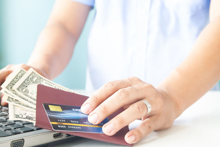 Online payment, Man's hands holding a credit card, passport and money. Using mobile phone for booking hotel and flight Hotel Trip Passport Cart Traveler Plastic Concept Entering E-commerce Cvv Ordering Wireless Tax Male Order Debit Smart Security Man Typing RISK Information Data Lifestyle Phone Ecommerce Keyboard Notebook Finance Electronic Internet Store Home Buy Technology Commerce Banking Using Purchase Business Pay Computer Shopping Laptop Hands Holding Payment Online  Card Credit