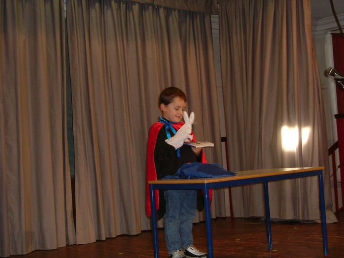 child magician Magic Magician Performance Performer  Rabbit Child Student Childhood Musician Full Length Sitting Skill  Curtain Performance Arts Culture And Entertainment Rehearsal Theatrical Performance