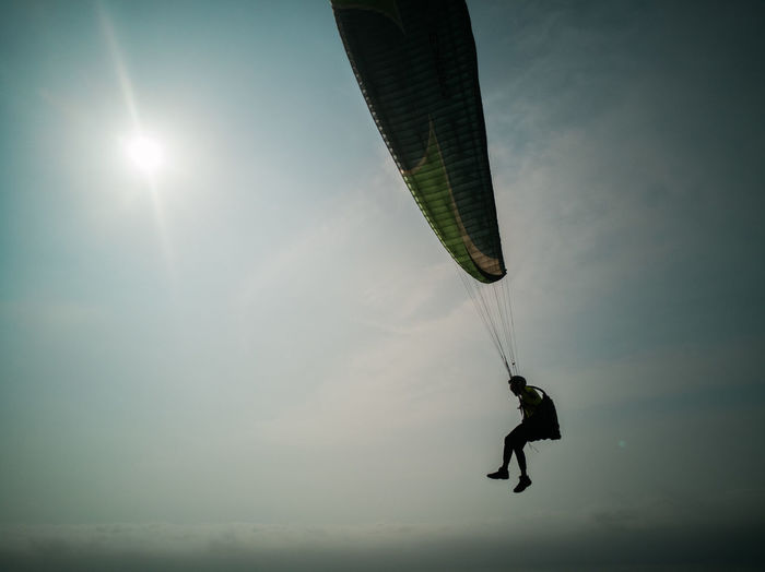 Flying Jumping Challenge Men Mid-air Motion Activity Stunt Extreme Sports Sport Parachute Paragliding Gliding Airshow Parasailing Recreation  Windsurfing