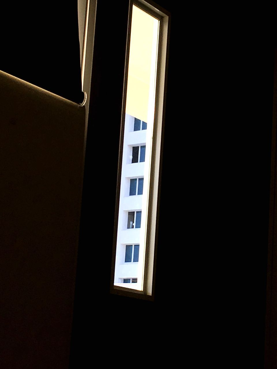 window, no people, black background, architecture, built structure, low angle view, indoors, night, illuminated, building exterior, close-up