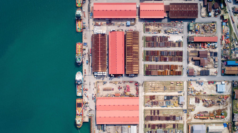 High angle view of commercial dock against blue sky