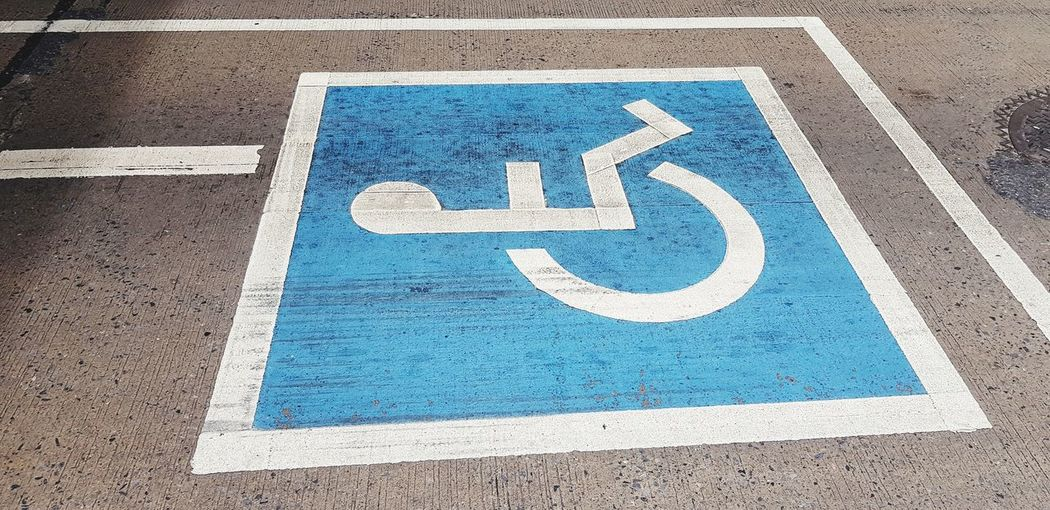 High angle view of disabled sign
