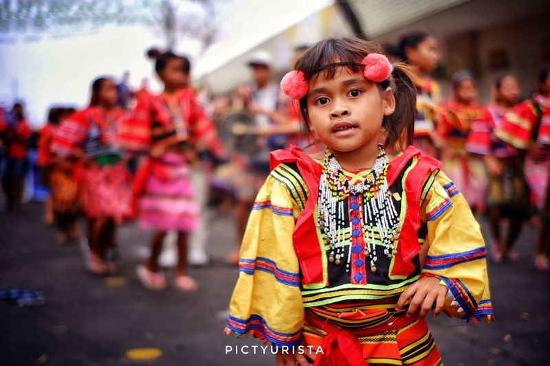 """Paslit"" A portrait of a Lumad child, during the Kadayawan sa Davao Festival, She is participating the Pamulak sa Kadalanan event and celebration. Fujifilm XT100 7artisans Randomphotos Composition Hobbyistphotographer Ndfiltered Philippines Landscapephotography Fuji Photographer Streetphotographyworldwide Newbie Lensculture Street_focus_on Streetphotography Streets_storytelling Streetsleaks Streetclassics Streetphotographycommunit EyeEm Selects Child Portrait City Childhood Looking At Camera Girls Arts Culture And Entertainment Boys Halloween Standing"