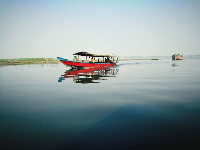 Water Reflection Beauty In Nature Floating On Water Lake Nautical Vessel Rippled Tranquility Transportation Outdoors Nature Day Sky Clear Sky Tranquil Scene People Large Group Of People