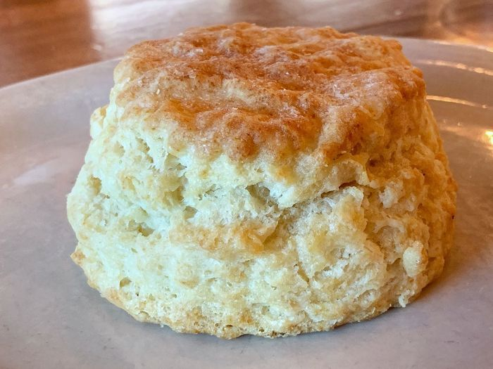 Fresh baked biscuit on a plate. Breakfast Pull Apart Warm Southern Hot Fresh Crumbly Biscuit Comfort Food Food Food And Drink Freshness Still Life Close-up Ready-to-eat Indoors  Bread Table Baked Indulgence High Angle View Temptation Serving Size Healthy Eating Wellbeing