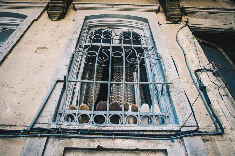Low angle view of window in old building
