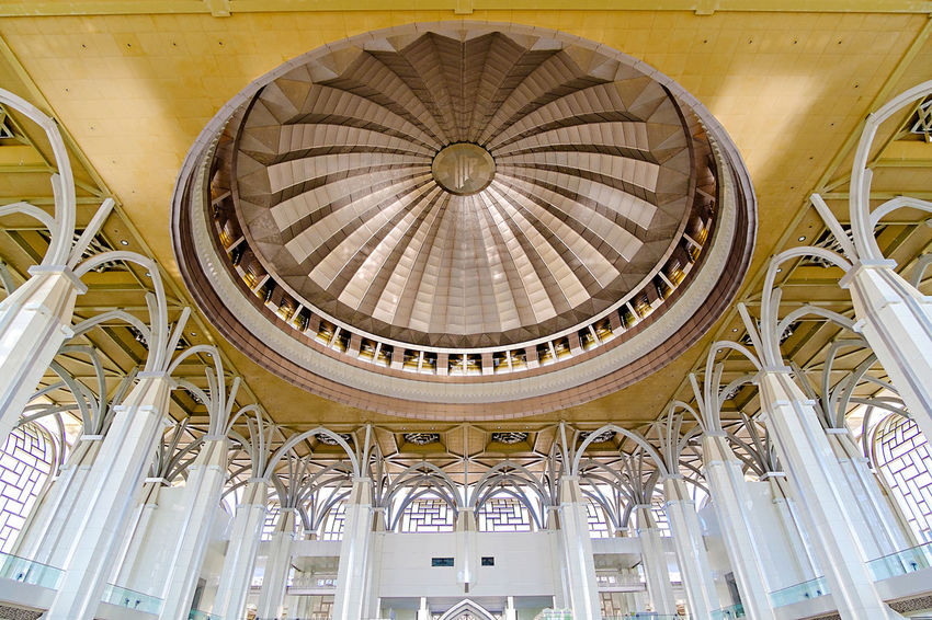 Low angle view of the Masjid Sultan Mizan Zainal Abidin dome. Arch Architectural Column Architectural Feature Architecture Built Structure Capital Cities  Ceiling Day Design Diminishing Perspective Dome Illuminated Interior Low Angle View Modern No People Ornate The Architect - 2016 EyeEm Awards Tourism Travel Destinations
