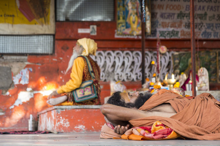 candid shot of sleeping sadhu at temple in Pushkar, India Pushkar Candid Candid Photography Cultures Focus On Foreground Hermit Hindu Temple Hinduism Indian Culture  Indianstories Indiapictures Life Lifestyle Priest Religion Sadhu Sleep Snapshot Streetlife Streetshot Temple - Building Traditional