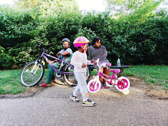 Happy Family Fun Family Young Girl Childhood Togetherness Child Friendship Girls Tree Boys Bicycle Fun Grass Children Growing Sibling