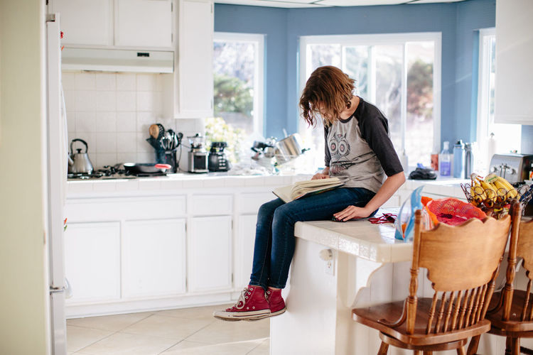 Woman sitting on seat at home