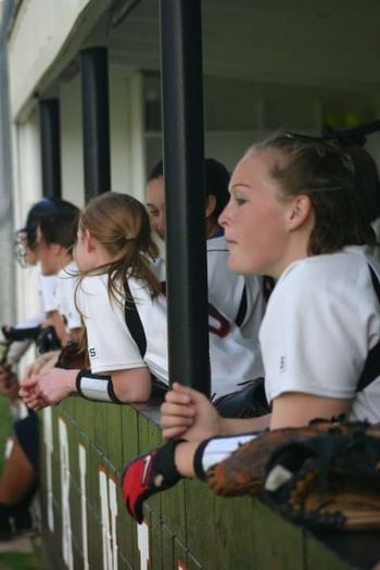 In the dug out. People Girls Friendship Young Women Softball Sports Team