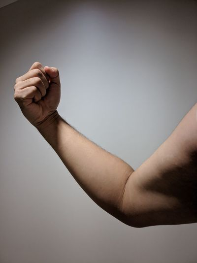 Right Hand Power Strength Contracted Arm Fist Right Arm Upper Arm Lower Arm Full Arm Muscle Clenched Fist EyeEm Selects Human Hand Human Body Part One Person Human Arm Indoors  Adult Human Finger Men Gesturing