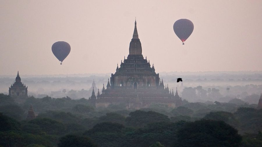 Ancient Architecture Bagan Balloons Over Pagodas In Bagan Cultures Famous Place History Myanmar Place Of Worship Religion Spirituality Sunrise Temple Temple - Building Travel Destinations
