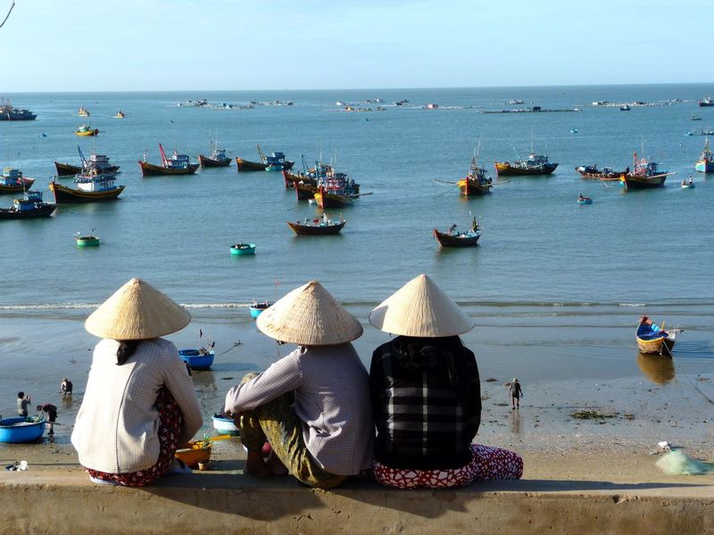 People Of The Oceans Women waiting for their husbands to come back from the early Morning fishing tour in Mui Ne, Vietnam Fishing Boat Fisherman Fishing Time Fishing Village Vietnam Vietnamese (null) Muine Ocean Ocean View On The Way People And Places Live For The Story