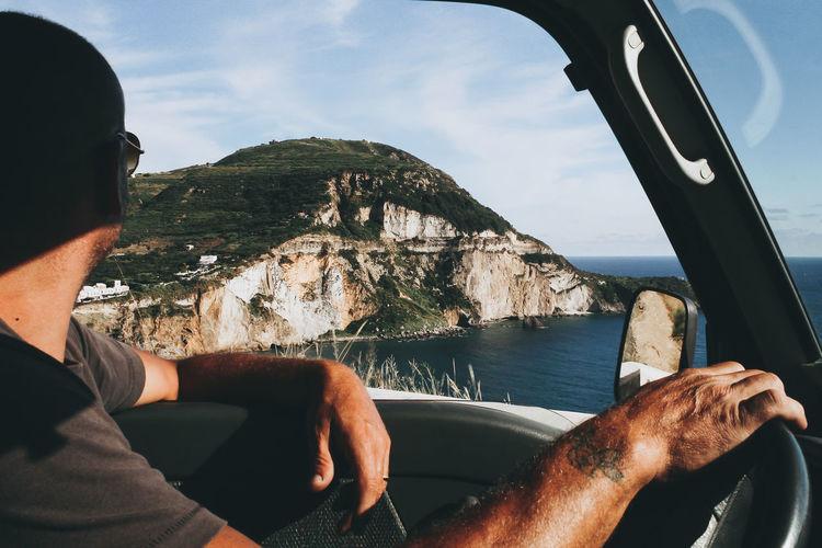 Man relaxing on rock in sea