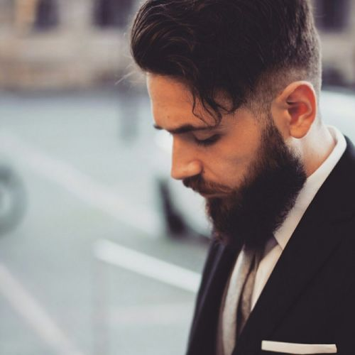 SIDE VIEW OF YOUNG MAN WITH BEARD