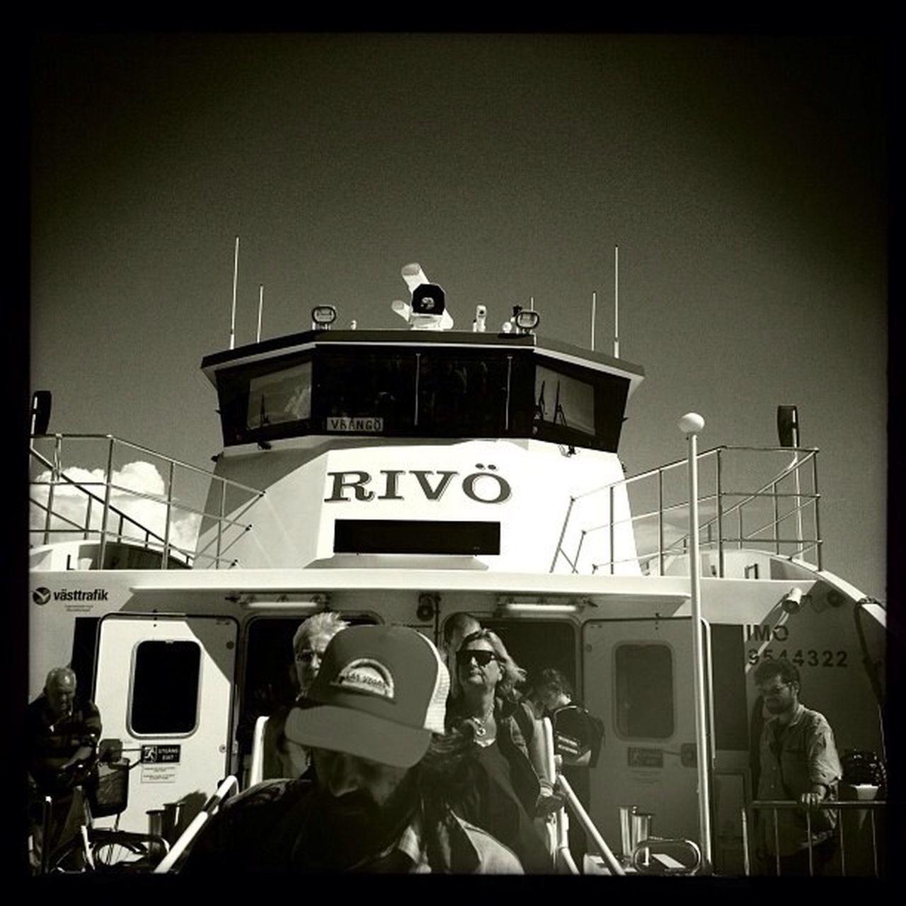 nautical vessel, transportation, clear sky, uniform, real people, outdoors, building exterior, men, sky, night, people