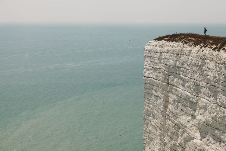 Beachy Head Beachyhead Nature's Diversities Coastline The Magic Mission Holiday Horizon Over Water Leisure Activity The Following Nature Outdoors Rock Formation Scenics Sea Sky Summer Tourism Tourist Tranquil Scene Travel Travel Destinations Unrecognizable Person Water Original Experiences Snap a Stranger Connected By Travel Lost In The Landscape