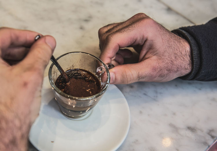 Espresso Close-up Food And Drink Foodphotography High Angle View Human Hand Refreshment Stirring